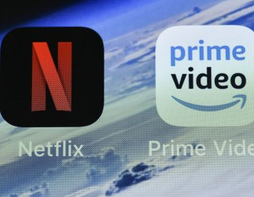In this Thursday, Nov. 15, 2018 file photo, the icons of streaming services Netflix and AmazonPrime Video are pictured on an iPhone in Gelsenkirchen, Germany. Streaming your favorite movies and TV shows is about to get way more expensive. Amazon Prime customers can add-on subscriptions to HBO, Showtime or Starz. (Martin Meissner/AP Photo, File)