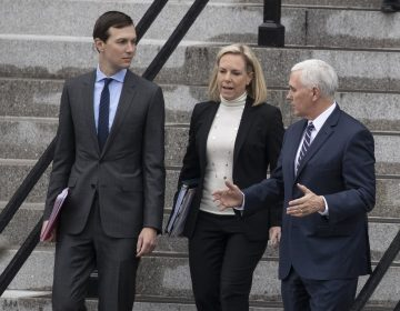 White House Senior Adviser Jared Kushner, (left), Homeland Security Secretary Kirstjen Nielsen, and Vice President Mike Pence, talk as they walk down the steps of the Eisenhower Executive Office Building on the White House complex, Saturday, Jan. 5, 2019, in Washington. (Alex Brandon/AP Photo)