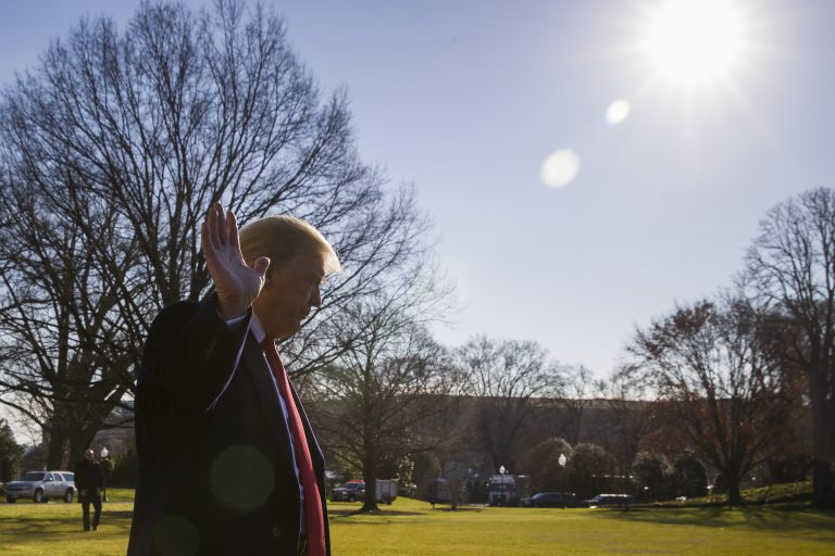 President Donald Trump waves as he departs after speaking on the South Lawn of the White House (AP Photo/Alex Brandon)