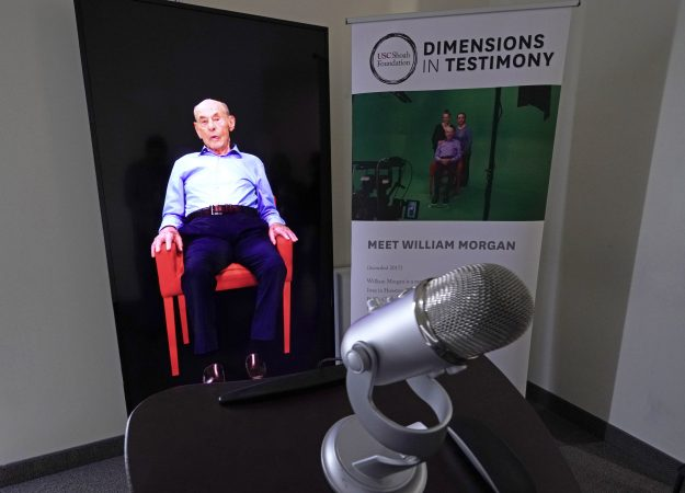 A Dimensions in Testimony exhibit featuring Holocaust survivor William Morgan using an interactive virtual conversation is shown at the the Holocaust Museum Houston Friday, Jan. 11, 2019, in Houston. The University of Southern California Shoah Foundation has recorded 18 interactive testimonies with Holocaust survivors over the last several years. (David J. Phillip/AP Photo)