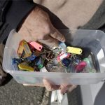In a photo taken Friday, Jan. 11, 2019, Vince Farias looks through a container with keys to his rental properties in Surf City, N.J. (Julio Cortez/AP Photo)