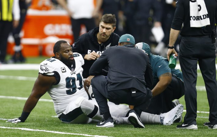 Philadelphia Eagles defensive tackle Fletcher Cox (91) is helped after injury against the New Orleans Saints in the first half of an NFL divisional playoff football game in New Orleans, Sunday, Jan. 13, 2019. (AP Photo/Butch Dill)