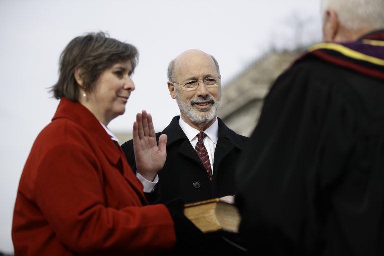 Pennsylvania Gov. Tom Wolf, accompanied by his wife Frances, takes the Oath of Office as he is sworn in for his second term, Tuesday, Jan. 15, 2019, at the state Capitol in Harrisburg, Pa. (Matt Rourke/AP)