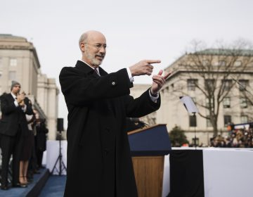 Pennsylvania Gov. Tom Wolf gestures after he was sworn in for his second term, Tuesday, Jan. 15, 2019, at the state Capitol in Harrisburg, Pa. (AP Photo/Matt Rourke)