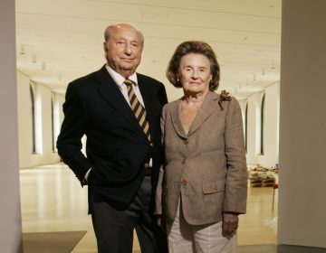 In this September 2007 photo, Raymond and Ruth Perelman pose for a photo in the exhibition gallery for the opening of the Philadelphia Museum of Art's Ruth and Raymond G. Perelman Building in Philadelphia. The businessman who built a fortune buying and selling factories and became one of the Philadelphia region's greatest philanthropists has died. Perelman was 101. His son Ronald Perelman says in a statement that his father died Monday night, Jan. 15, 2019. (Michael Bryant/The Philadelphia Inquirer via AP)