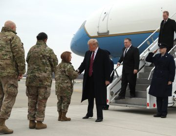 President Donald Trump greets Col. Dawn C. Lancaster, Commander Air Force Mortuary Affairs, at Dover Air Force Base, Del., Saturday, Jan. 19, 2019, as he arrives to pay tribute to the four Americans killed in a suicide bomb attack in Syria as their remains are returned as Chief Master Sgt. Danielle M. Hirvela, Chief Enlisted Manager, Air Force Mortuary Affairs Operations, second from left, and Chief Master Sgt. Anthony W. Green Command Chief Master Sergeant, 436th Airlift Wing, Dover Air Force Base, (left), watch. Following Trump are Secretary of State Mike Pompeo and acting Secretary of Defense Patrick Shanahan, (right). (Andrew Harnik/AP Photo)