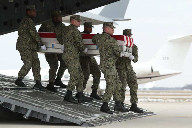 A U.S. Navy carry team moves a transfer case containing the remains of Scott A. Wirtz, Saturday, Jan. 19, 2019, at Dover Air Force Base, Del. According to the Department of Defense, Wirtz, a civilian and former Navy SEAL from St. Louis, Mo., was killed Jan. 16, 2019, in a suicide bomb attack in Manbij, Syria. President Donald Trump attend the return ceremony. (Andrew Harnik/AP Photo)