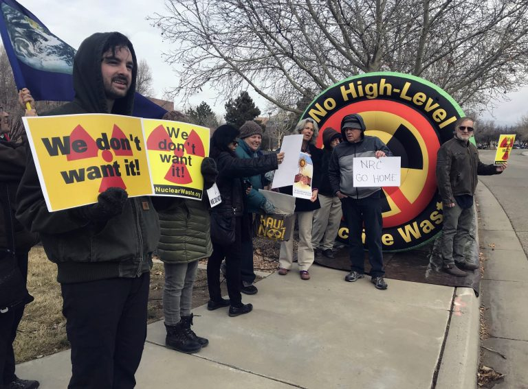 In this Tuesday, Jan. 22, 2019 photo, Brendan Shaughnessy, (left), with the Nuclear Issues Study Group, protests with other activists ahead of a meeting of a U.S. Nuclear Regulatory Commission panel in Albuquerque, N.M. (Susan Montoya Bryan/AP Photo)