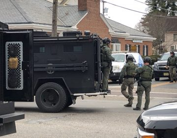 A police SWAT team arrives at the site of a standoff between law enforcement and a fugitive they were trying to arrest, Wednesday, Jan. 23, 2019 in Salem, N.J. New Jersey State Police and other law enforcement agencies responded to Salem after reports that shots were fired during the standoff. (Geoff Mulvihill/AP Photo)