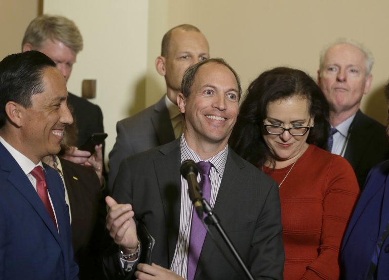 In this Jan. 24, 2019 file photo, Assemblyman Brian Maienschein, center, smiles at a news conference where he announced he was switching party registration from Republican to Democrat, in Sacramento,   California (Rich Pedroncelli/AP)