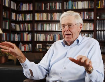 In this photo May 22, 2012 file photo, Charles Koch speaks in his office at Koch Industries in Wichita, Kan. Hundreds of wealthy donors gathered by billionaire industrialist Charles Koch will be meeting this weekend of Jan. 26, 2019, for the first time since the influential conservative political network announced it won't spend any money on the 2020 presidential race. (Bo Rader/The Wichita Eagle via AP, File)
