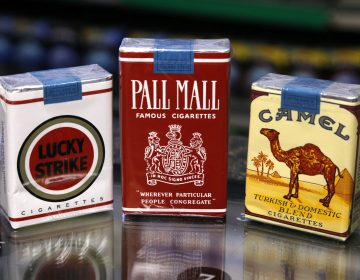In this Friday, July 17, 2015 photo, unfiltered Lucky Strike, Pall Mall, and Camel cigarettes, Reynolds American brands, are on display at a Smoker Friendly shop in Pittsburgh. (Gene J. Puskar / The Associated Press)