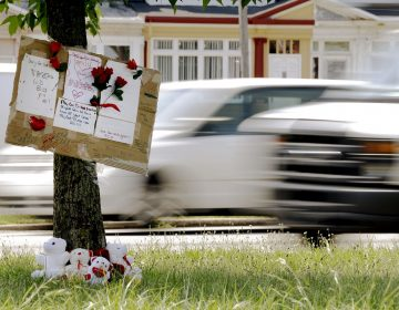 A makeshift memorial is shown near the location where a mother and three young sons were struck and killed while trying to cross a busy highway after dark, Wednesday, July 17, 2013 in Philadelphia. A fourth son was injured in the crash Tuesday night on Roosevelt Boulevard, a major artery that divides neighborhoods in north and northeast Philadelphia.  (Matt Rourke/AP Photo)