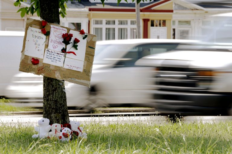 A makeshift memorial is shown near the location where a mother and three young sons were struck and killed while trying to cross a busy highway after dark, Wednesday, July 17, 2013, in Philadelphia.  (Matt Rourke/AP Photo)