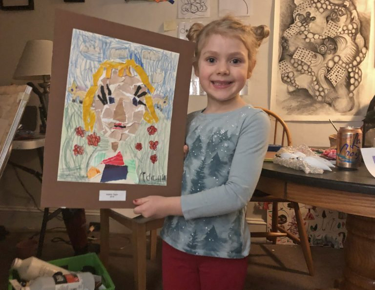 Adaline Taylor, 6, shows off her artwork. (Christine Fennessy/For WHYY)