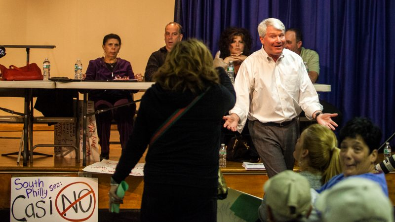 Labor leader John Dougherty reacts to jeers from audience members during a meeting on a proposed casino near the sports complex in South Philadelphia on Nov. 12, 2014. (Brad Larrison/for NewsWorks)