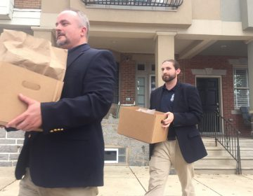 Unmarked boxes taken from John 'Johnny Doc' Dougherty's home during a raid in 2016. (Bobby Allyn/WHYY)