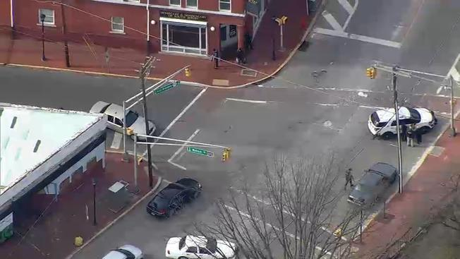 Schools and county government buildings in Salem, N.J. are on lockdown amid an armed standoff between police and a fugitive. (Image courtesy of NBC10)