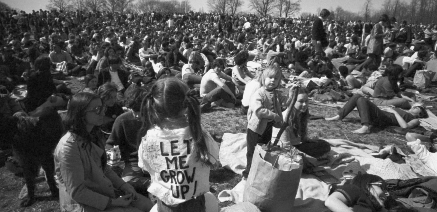Earth Week crowd in Philadelphia, including a young girl wearing a