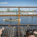 People now use the Delaware for recreation, like these visitors to Spruce Street Harbor Park. Prior to the Clean Water Act, the Delaware River was so polluted no one would have considered basking so close to it. But the regulation has not been updated for decades, and scientists say hidden dangers to fish and wildlife still exist. (Brandon Eastwood for WHYY)