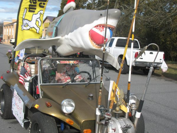 Art Wilson of Clayton is in his first parade. He was proud to show off his dune buggy. The shark was autographed by Bruce Meyers, the creator of the dune buggy. (John Mussoni/WHYY)