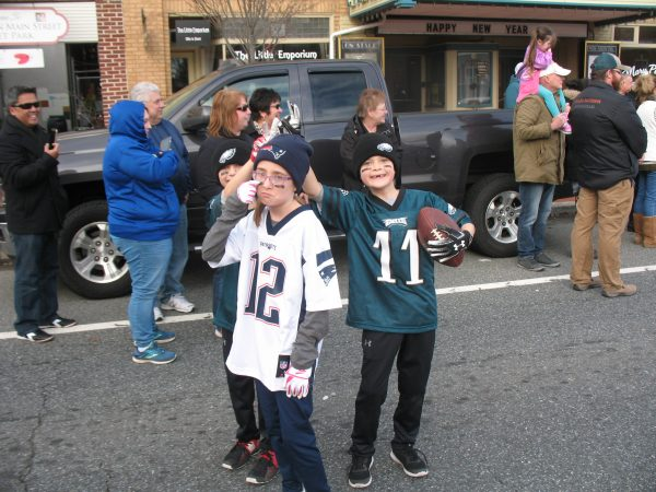 Nick Foles (background left), Tom Brady, and Carson Wentz remember the Super Bowl in the form of George, Katlyn, and Kyle Barbera of Townsend. (John Mussoni/WHYY)