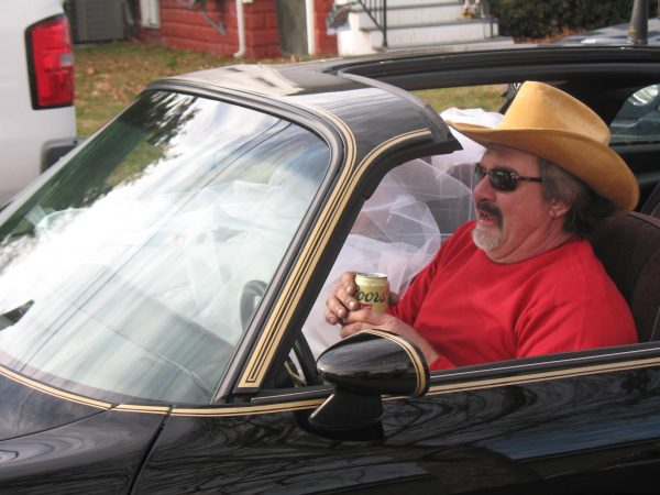 There were two nods to Burt Reynolds who passed away in 2018. This look-alike lives in the Dutch Neck farms development in Middletown. (John Mussoni/WHYY)