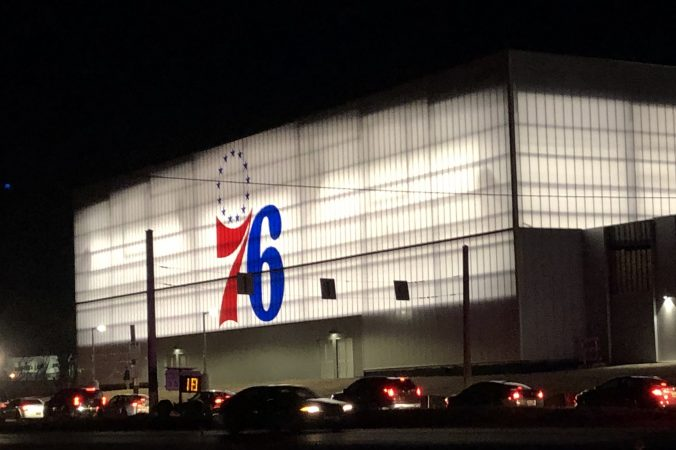 A steady steam of vehicles streamed into Wilmington's new arena for the Delaware Blue Coats on Wednesday. (Cris Barrish, WHYY News)