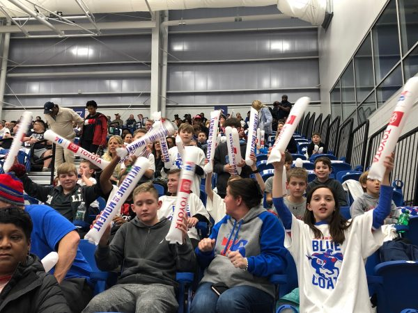 A group of young fans cheers on the Blue Coats during their Wilmington debut Wednesday. (Cris Barrish/WHYY)
