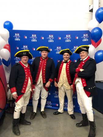 Blue Coats in Revolutionary War garb greeted fans at the arena Wednesday. (Cris Barrish/WHYY)