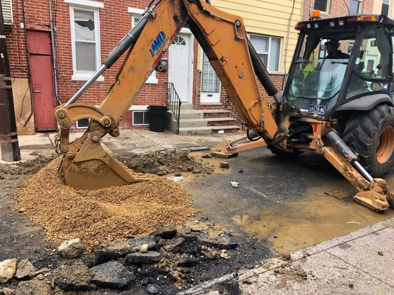A Philadelphia Water Department crew completed the fix of a water main break in South Philadelphia as the department steps up efforts to manage water main breaks during the winter. (Darryl Murphy/WHYY)