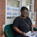 Daphne Goggins sits on her front porch in North Philadelphia. (Lindsay Lazarski/WHYY)