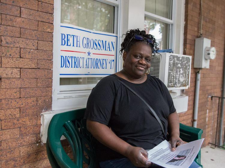 Daphne Goggins sits on her front porch in North Philadelphia. (Lindsay Lazarski/WHYY)