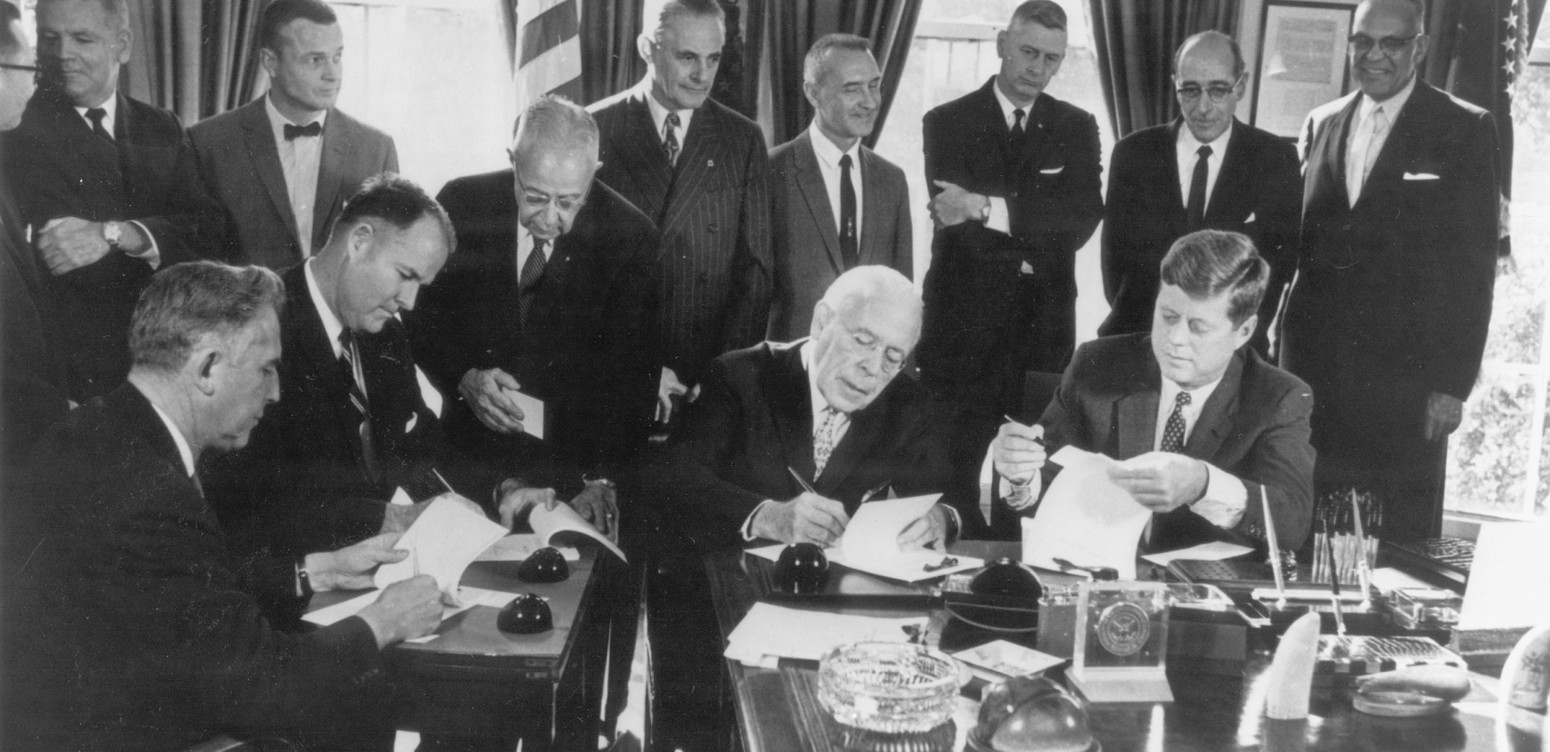 Governors Robert Meyner of New Jersey, Elbert Carvel of Delaware, and David Lawrence of Pennsylvania joined President John F. Kennedy at the White House on November 2, 1961, to participate in a ceremonial signing of the Delaware River Basin Compact. (DRBC)