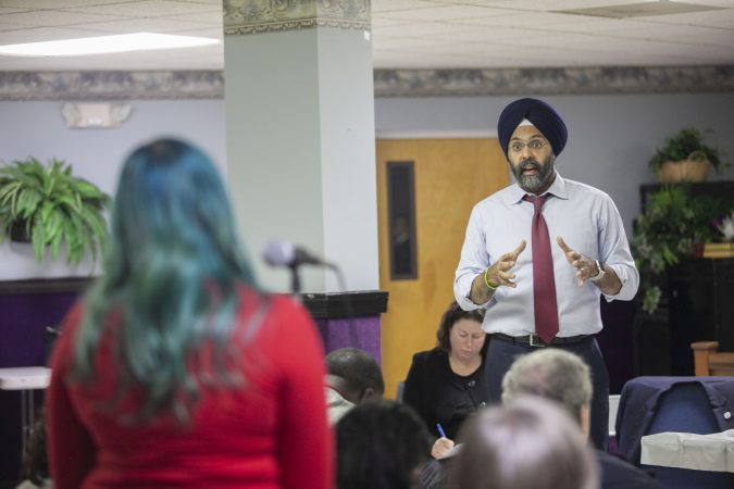 New Jersey Attorney General Gurbir Grewal responds to an audience member during a community listening session on police use of force in Bridgeton, N.J., Jan. 23, 2019. (Miguel Martinez for WHYY)