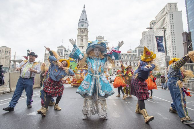 Members of Golden Sunrise rehearse their performance on Market St. prior to the start of the parade. (Jonathan Wilson for WHYY)