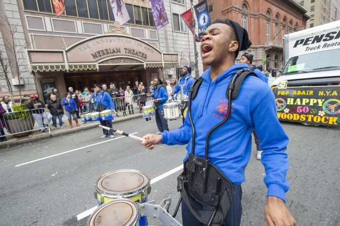 Members of the Sixers Stixers perform in front of the Merriam Theater. (Jonathan Wilson for WHYY)