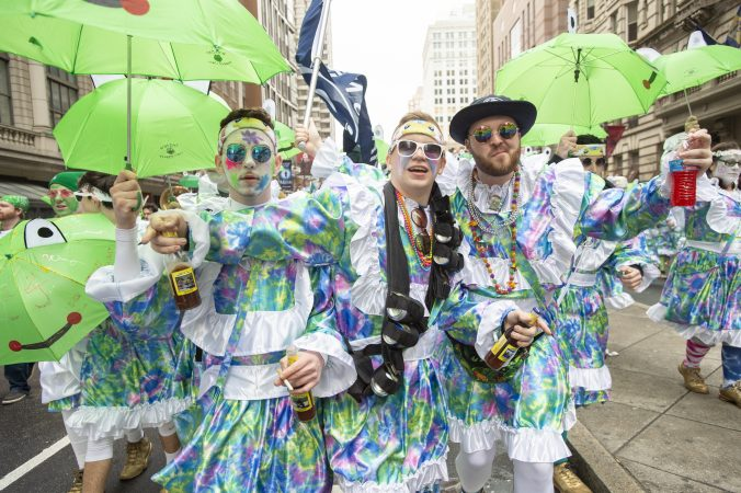 Members of the Wench Division's Froggy Carr entertain the crowd as they wait for judging and the march down Broad St. (Jonathan Wilson for WHYY)