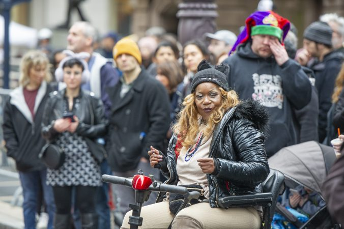 Carla Cowae of Newark DE gets her groove on as the Comic Division passes by on Broad St. (Jonathan Wilson for WHYY)