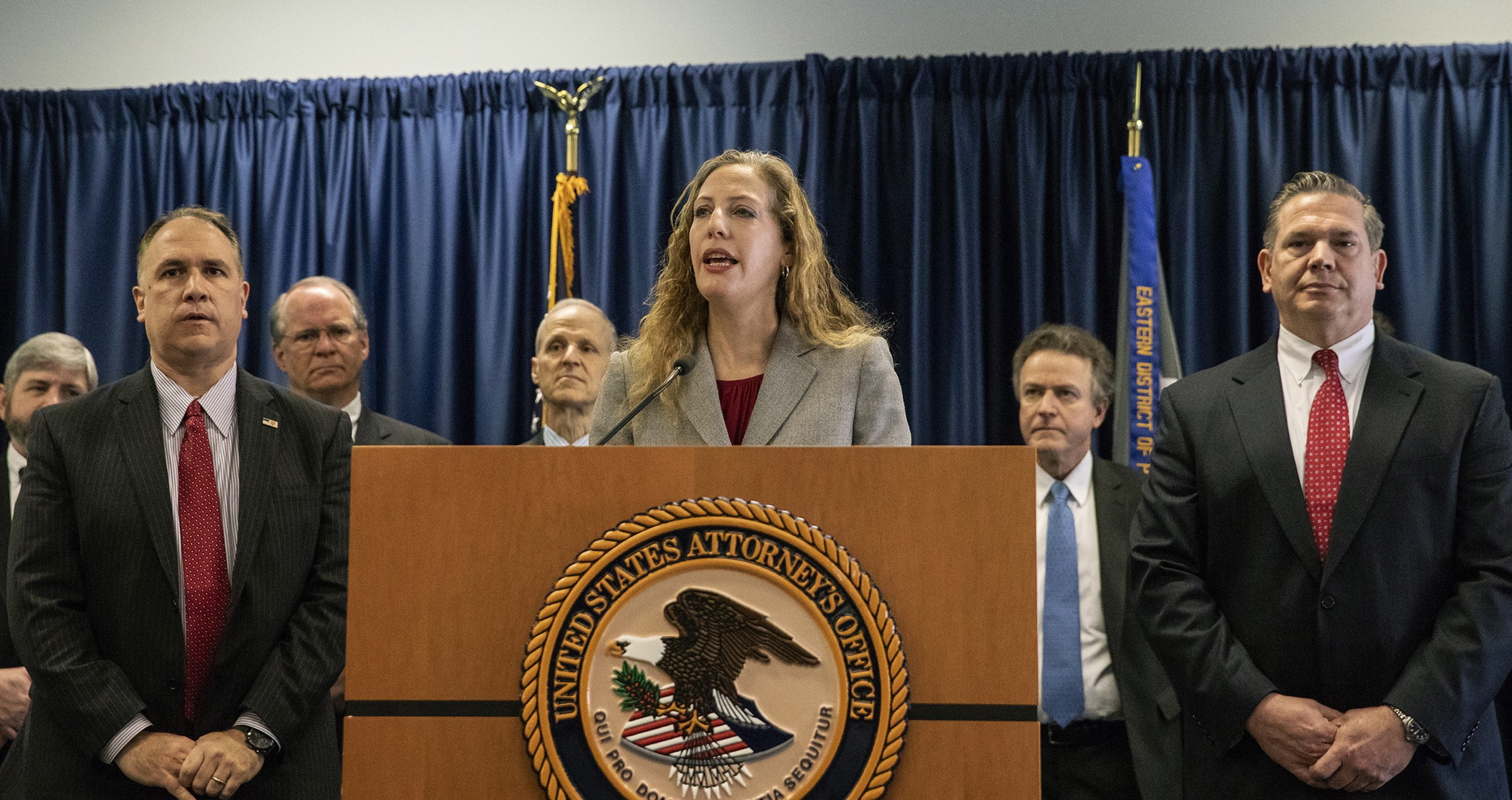 "Jennifer Arbittier Williams, assistant United States Attorney with the Criminal Division of the U.S. Attorney's Office in Philadelphia, speaks at the podium next to Michael Harpster, right, FBI special agent of the Philadelphia Division, and Guy Ficco of the IRS, left, in the indictment of Local 98 leader John ""Johnny Doc"" Dougherty at the U.S. Attorney's office in Center City Philadelphia on Wednesday, Jan. 30, 2019."