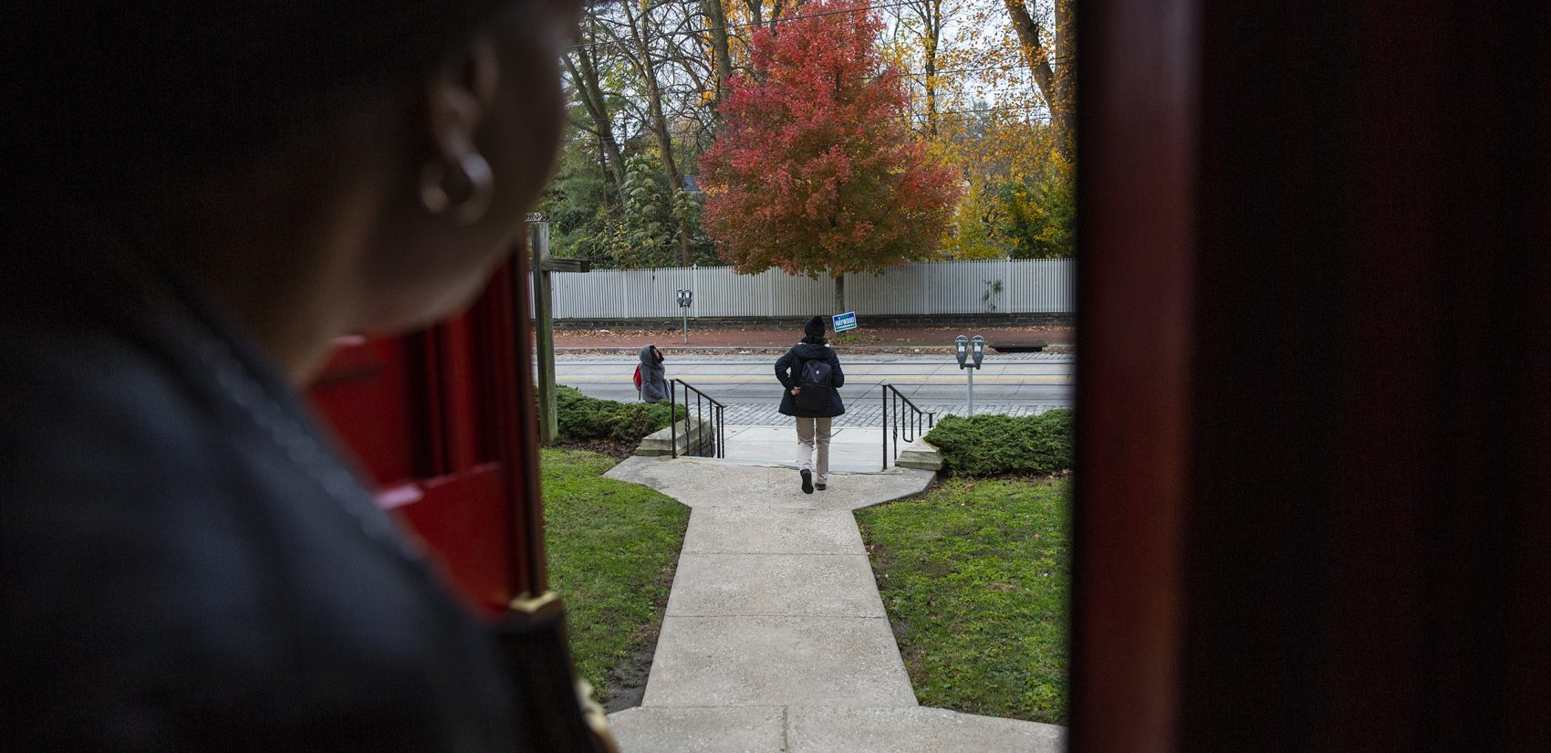 Oneita Thompson watches from the door of the First United Methodist Church of Germantown as her daughter Christine, who is 16, leaves for school on Monday, Nov. 12, 2018. (Heather Khalifa/The Philadelphia Inquirer)