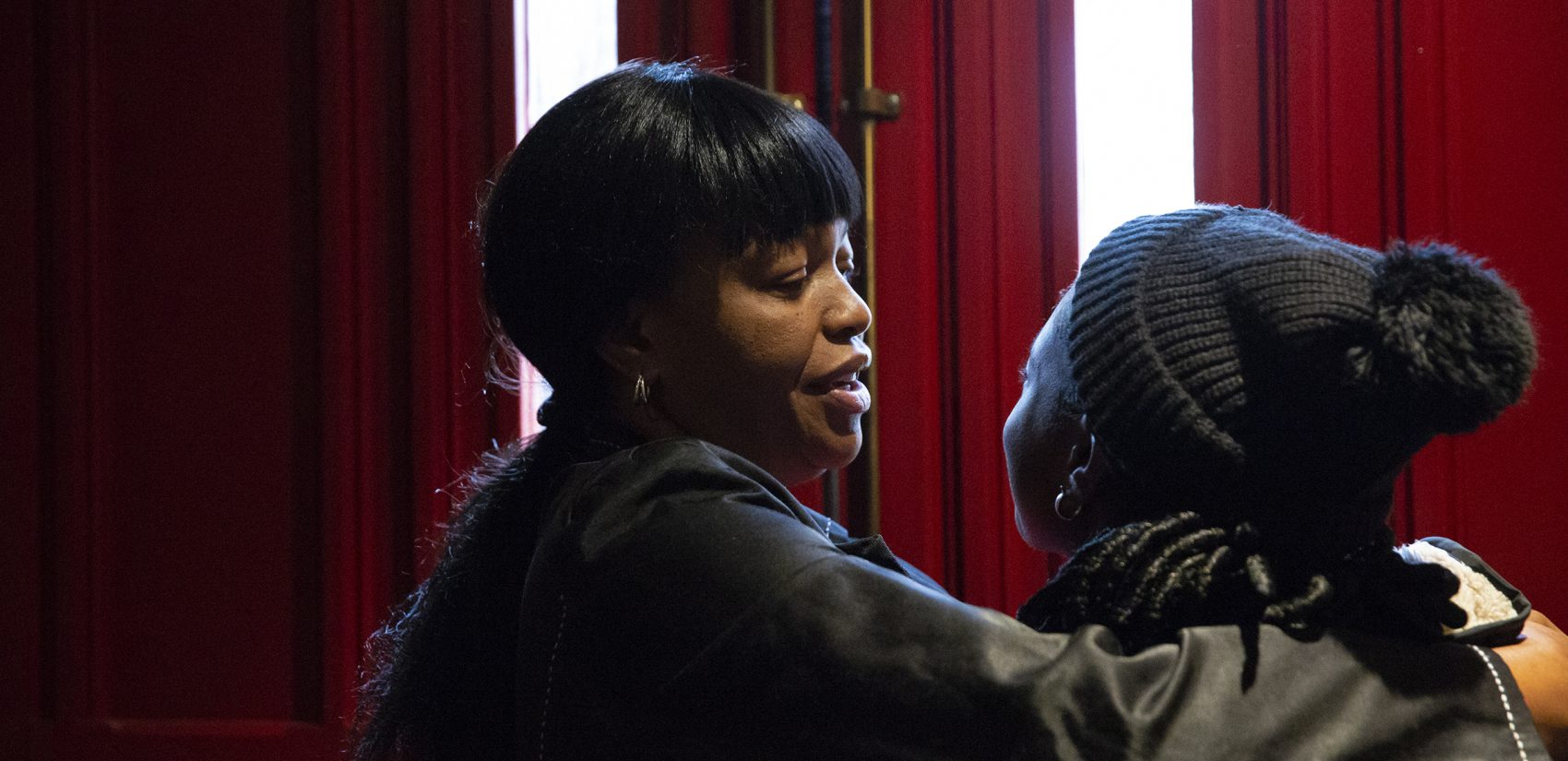 Oneita Thompson hugs her daughter Christine, who is 16, inside the First United Methodist Church of Germantown before she leaves for school on Monday, Nov. 12, 2018. (Heather Khalifa/The Philadelphia Inquirer)