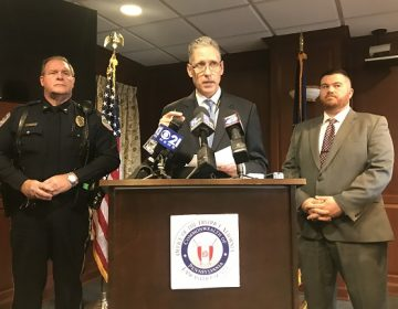 Lancaster County District Attorney Craig Stedman, center, speaks to reporters Dec. 6, 2018 about the October 26 multi-vehicle crash that killed two Warwick High School students. At left is Lititz Borough Police Chief Kerry Nye. At right, Lancaster County Assistant District Attorney Jared Hinsey. (Brett Sholtis/WITF News)