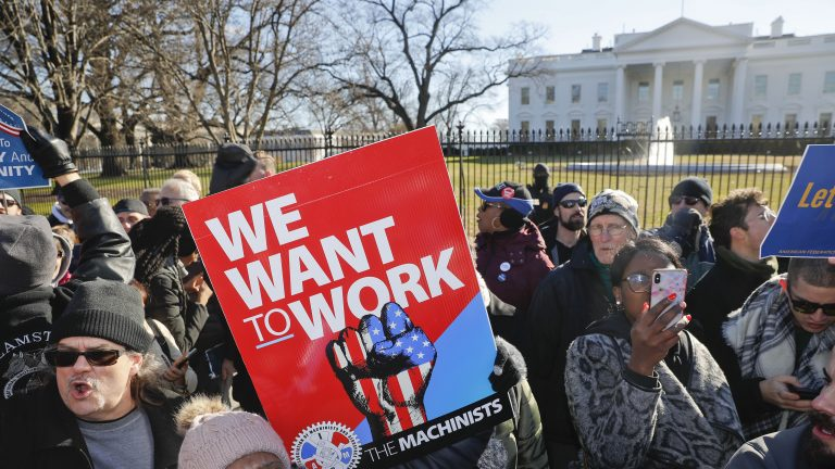 Union members and other federal employees protest in front of the White House on Thursday. Many are out of work as the partial government shutdown has dragged on longer than any in history. (Pablo Martinez Monsivais/AP)