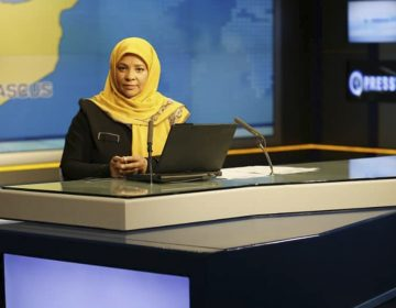 American-born news anchor Marzieh Hashemi sits in a studio in Tehran where she works for Iran's state television. She was arrested Sunday during a visit to the U.S., her family says. She is testifying behind closed doors to a grand jury in Washington, D.C., in an unspecified case, a U.S. judge said Friday. (Press TV/AP)