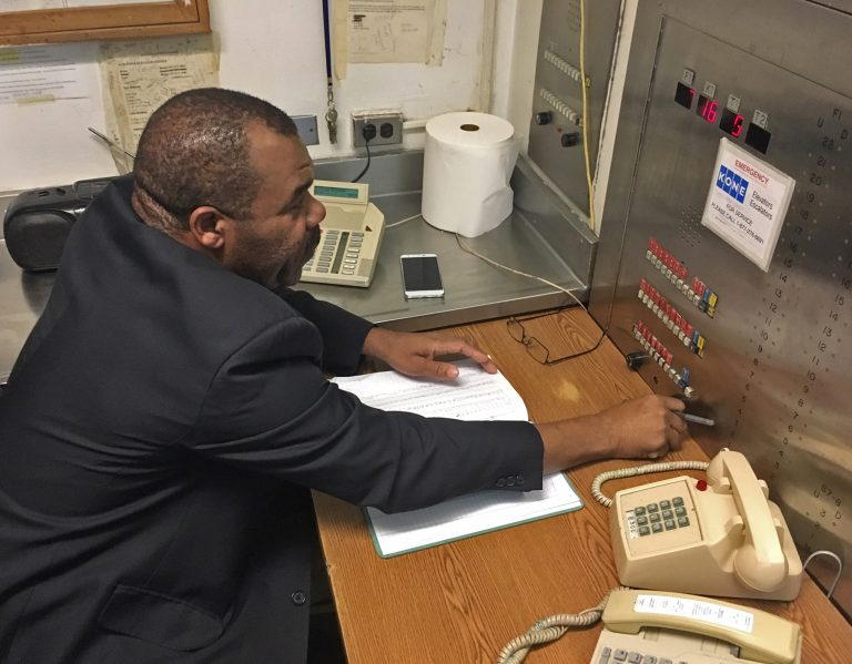 Roswealth Gordon works in the elevator pilot room at Bellevue Hospital in Manhattan. (Jad Sleiman/WHYY)