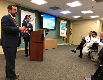 Assistant New Jersey Health Commissioner Jeff Brown and Commissioner Shereef Elnahal extol the benefits of medical marijuana at a gathering Wednesday in Atlantic City. (Joe Hernandez/WHYY)