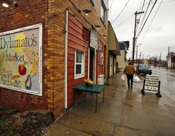 In this March 1, 2018 photo, a customer leaves Dylamatos Market owned by Dianne Shenk in the Hazelwood neighborhood of Pittsburgh. About a quarter of Shenk's customers pay with benefits from the federal Supplemental Nutrition Assistance Program. (Gene J. Puskar/AP)