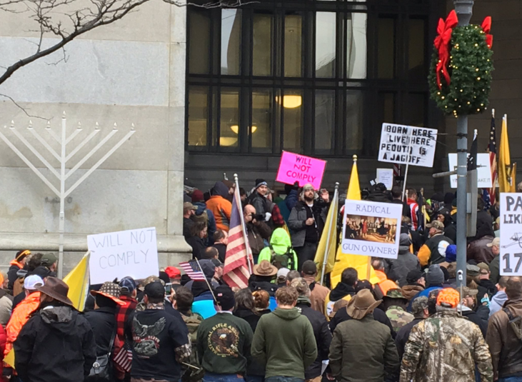 Demonstrators take part in a pro-gun rights rally outside of the City-County Building in downtown Pittsburgh. (Lucy Perkins/90.5 WESA)