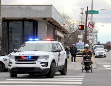 Police block traffic at Broad Street and Oregon Avenue during a manhunt for a man from Delaware. (Emma Lee/WHYY)